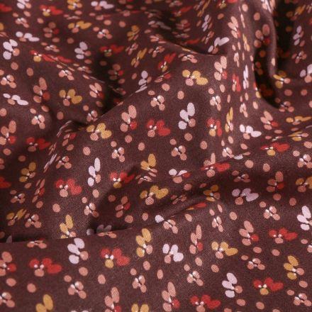 Tissu Coton imprimé Arty Petites pétales de fleurs ocre et rose sur fond Prune - Par 10 cm