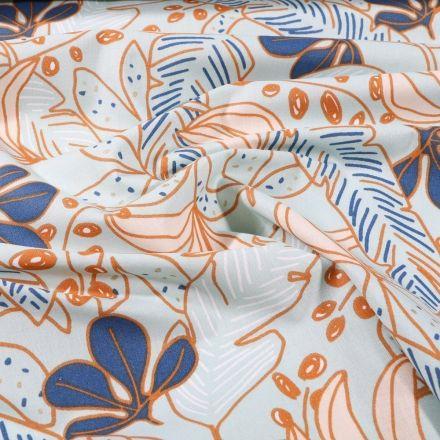 Tissu Coton imprimé Arty Grandes feuilles colorées sur fond Vert menthe clair - Par 10 cm