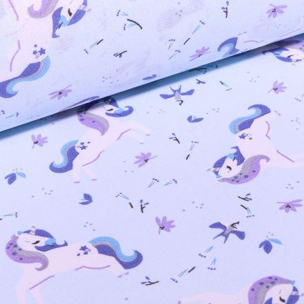 Tissu Coton imprimé Arty Licornes et petites fleurs sur fond Bleu ciel