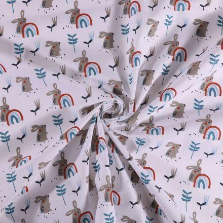 Tissu Coton imprimé Lapins et arcs en ciel sur fond Blanc - Par 10 cm