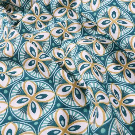 Tissu Coton imprimé Arty Rosaces ocres et bleu pétrole sur fond Bleu - Par 10 cm
