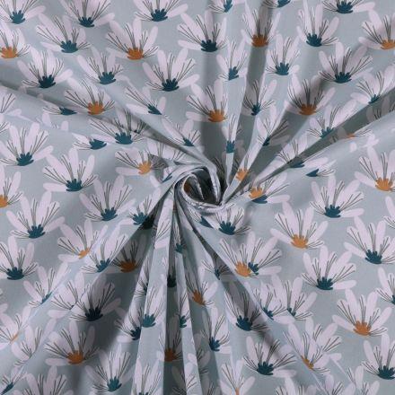 Tissu Coton imprimé Fleurs blanches ocre et vertes sur fond Bleu clair - Par 10 cm