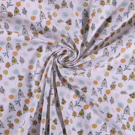Tissu Coton imprimé Arty Cage aux oiseaux anis et orange sur fond Blanc - Par 10 cm