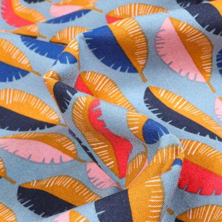 Tissu Viscose Arty Feuilles multicolores sur fond Bleu