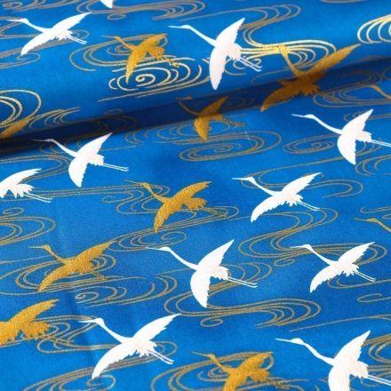 Tissu Coton Robert Kaufman Imperial collection Cigognes or et blanches sur fond Bleu - Par 10 cm