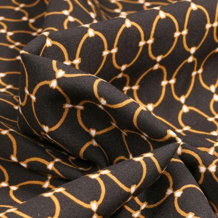 Tissu Viscose Arty Anneaux Or sur fond Noir
