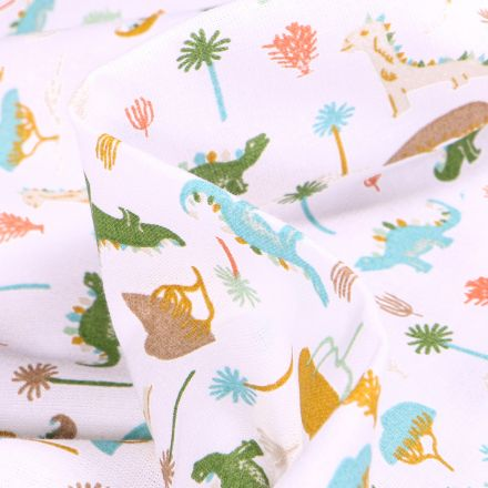 Tissu Coton imprimé Arty Dino colorés sur fond Blanc