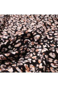 Tissu Jersey Viscose Pétales de fleurs blanches et marron sur fond Noir