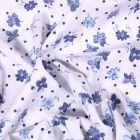 Tissu Coton extensible  Fleurs et petits pois bleus sur fond Blanc - Par 10 cm