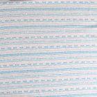 Tissu Sweat  envers  molletonné  imprimé Aztèque turquoise sur fond Gris clair chiné - Par 10 cm