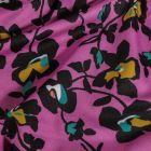 Tissu Maillot de bain Fleurs noires ocre et vertes sur fond Violet - Par 10 cm