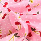 Tissu Coton enduit Cerises et pois sur fond Rose