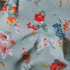 Tissu Coton imprimé Bouquets de fleurs sur fond Menthe- Par 10 cm