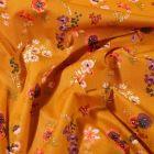 Tissu Coton enduit Fleuris sur fond Jaune curry - Par 10 cm
