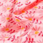 Tissu Coton enduit Pâquerettes sur fond Rose