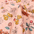 Tissu Jersey Coton Papillons cerises et fleurs sur fond Rose saumon