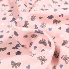 Tissu Jersey Coton Petits nœuds et cœurs sur fond Rose pâle