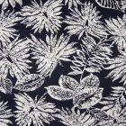 Tissu Coton Satiné extensible  Feuillages blancs sur fond Bleu marine - Par 10 cm
