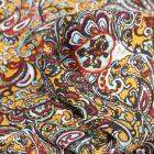 Tissu Crêpe georgette Arabesque coloré sur fond Jaune