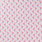 Tissu Coton Enduit Flamants roses sur fond Gris - Par 10 cm