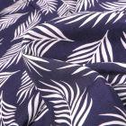 Tissu Viscose Popeline Feuilles de palme blanches sur fond Bleu marine