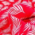 Tissu Viscose Popeline Feuilles de palme blanches sur fond Rouge
