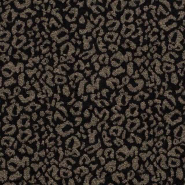 Tissu Lainage Tâches léopard beiges sur fond Noir - Par 10 cm