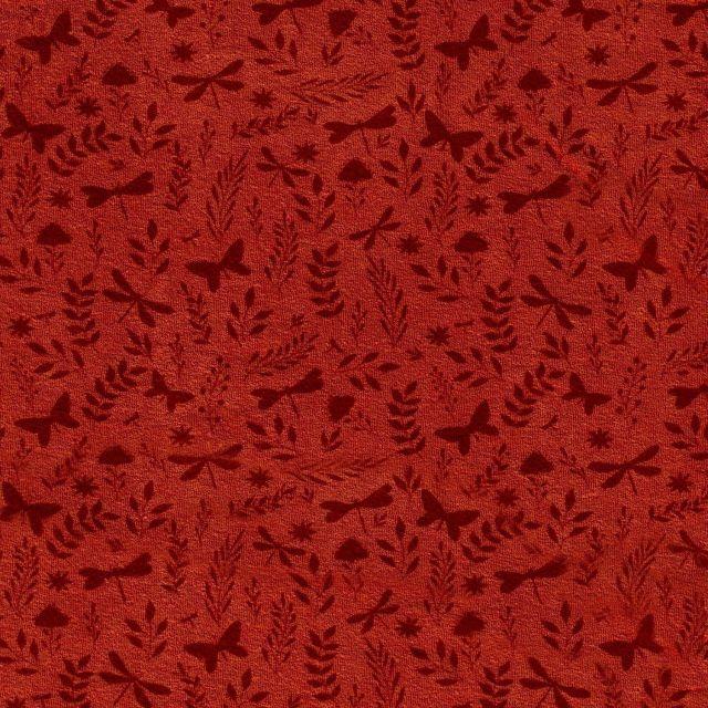 Tissu Jersey Velours Eponge Libellules papillons et feuilles sur fond Brique - Par 10 cm