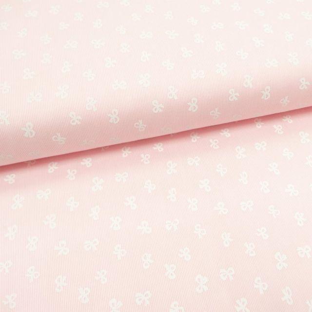 Tissu Piqué de coton Rose clair Noeuds Blancs 10 mm - Par 10 cm
