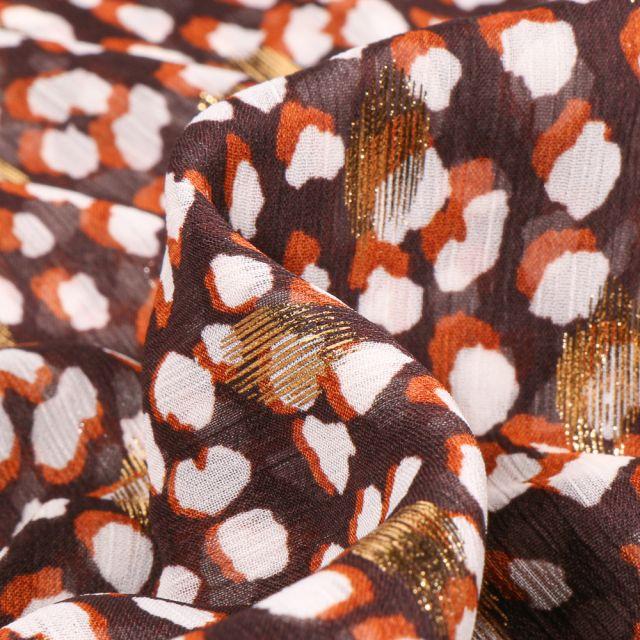 Tissu Mousseline Taches blanches orange et dorés sur fond Marron