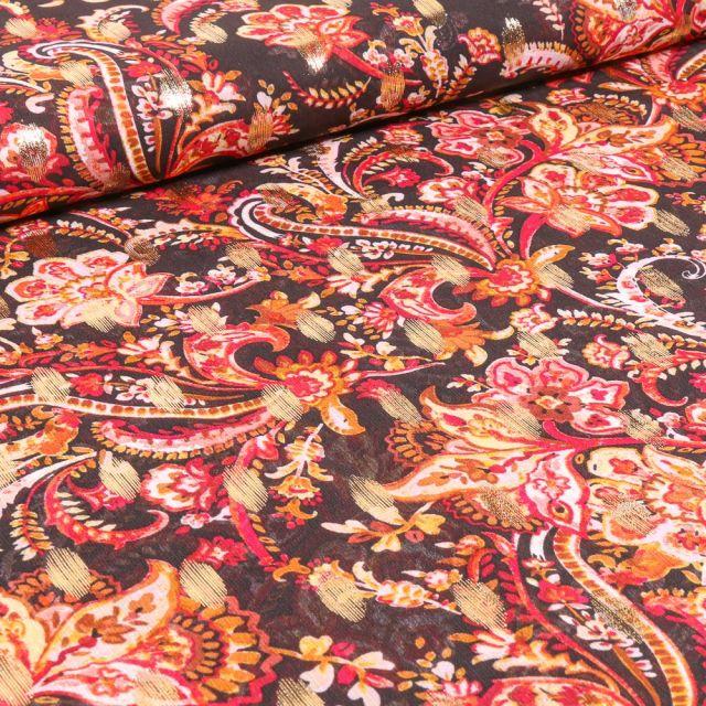 Tissu Mousseline Arabesques fleuris rouge sur fond Noir