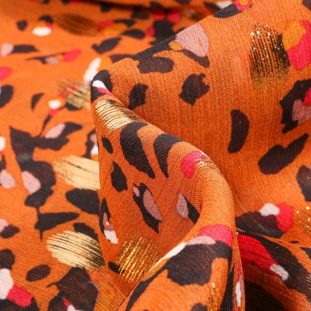 Tissu Voile Polyester Taches léopard lurex sur fond Orange