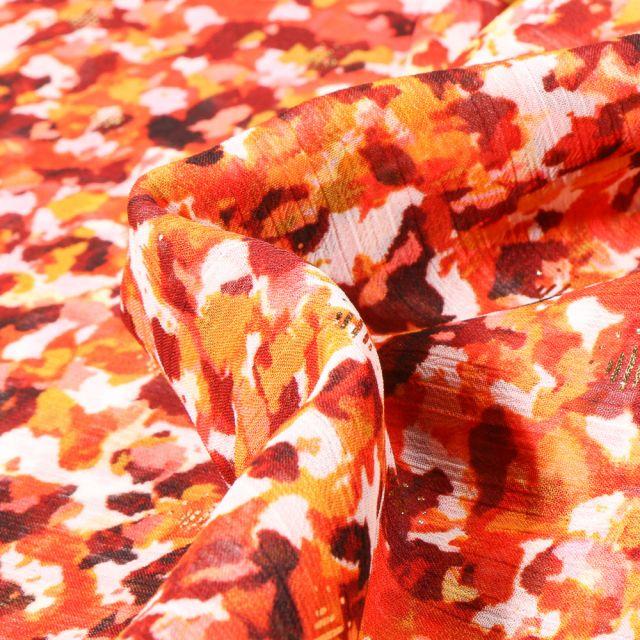 Tissu Mousseline Flora sur fond Orange