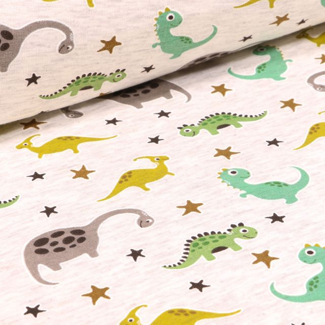 Tissu Sweat envers minky Dinosaures multicolores sur fond Beige chiné
