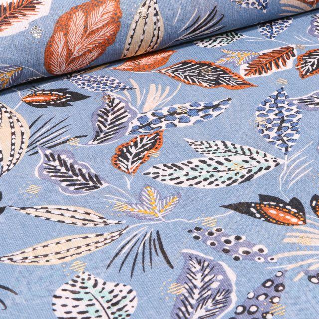 Tissu Mousseline Feuilles ethniques sur fond Bleu ciel