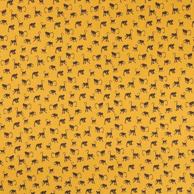 Tissu Satin imprimé Singes marron foncé sur fond Moutarde - Par 10 cm