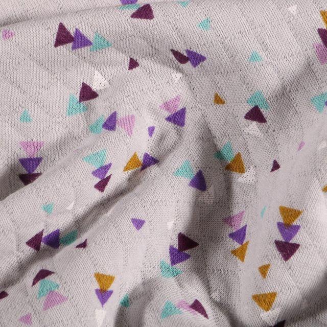 Tissu Sweat matelassé léger Triangles multicolores sur fond Gris - Par 10 cm
