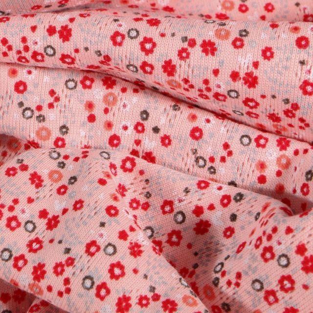 Tissu Jersey Coton ajouré Petites fleurs rouges sur fond Rose - Par 10 cm