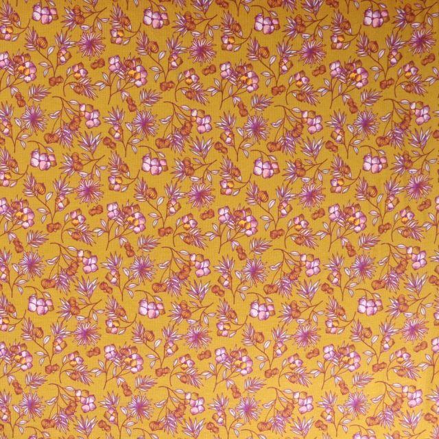 Tissu Jersey Modal Feuilles et fleurs sur fond Moutarde - Par 10 cm