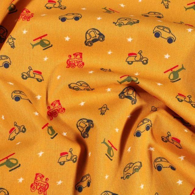Tissu Coton imprimé Véhicules de transports sur fond Jaune curcuma - Par 10 cm