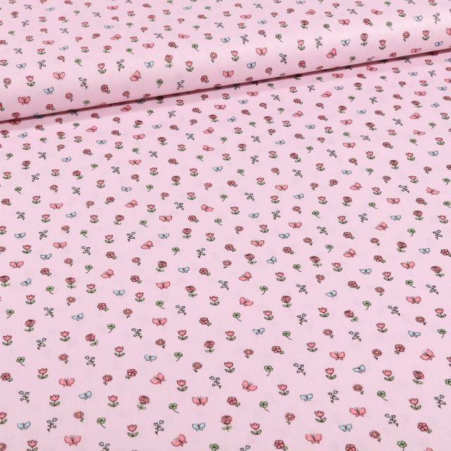 Tissu Coton imprimé Petits bouquets de fleurs et papillons sur fond Rose - Par 10 cm
