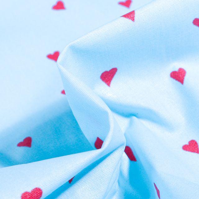 Tissu Coton enduit Petits cœurs rouges sur fond Bleu