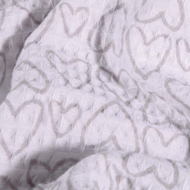 Tissu Nid d'abeille imprimé Cœurs gris sur fond Blanc - Par 10 cm