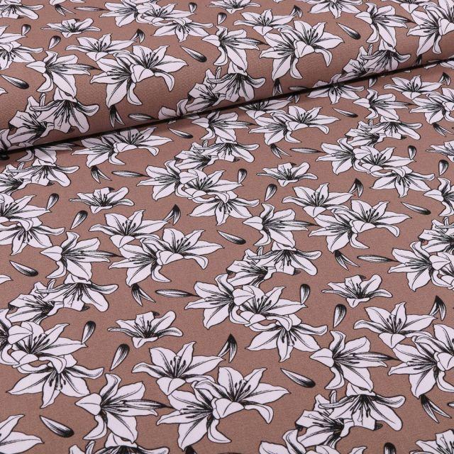 Tissu Toile Coton Lys blancs et noirs sur fond Marron - Par 10 cm