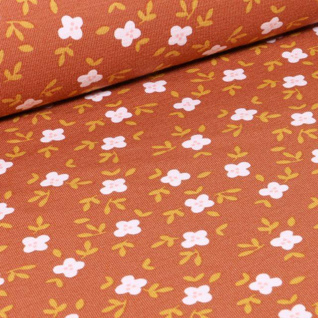 Tissu Jersey Coton Bio Fleurs blanches et feuilles sur fond Brique