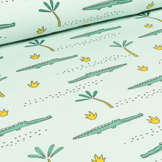 Tissu Jersey Coton Bio Crocodile et palmier sur fond Vert menthe