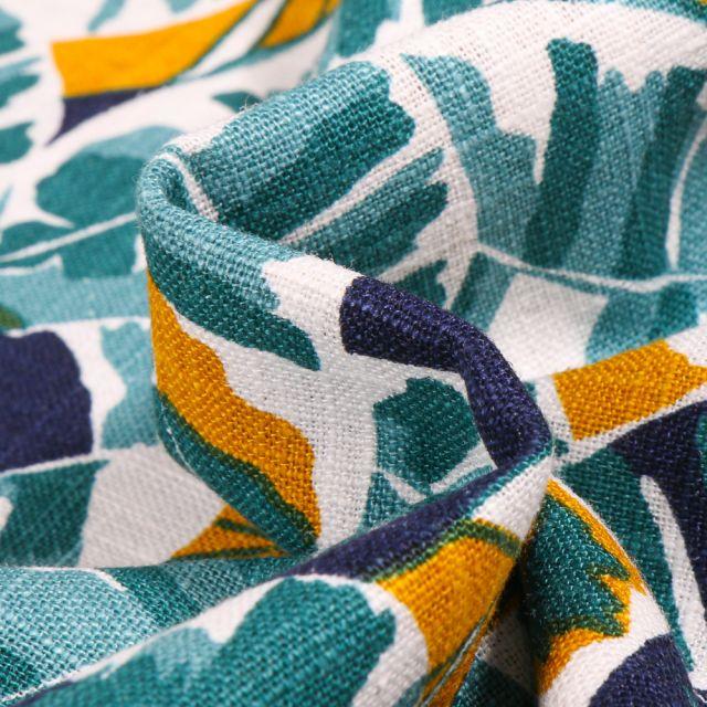 Tissu Lin Feuilles colorées bleu sur fond Blanc