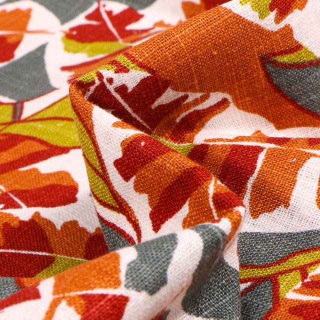 Tissu Lin Feuilles colorées orange sur fond Blanc