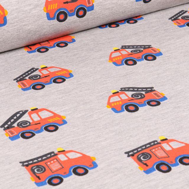 Tissu Jersey Polycoton Camions de pompiers sur fond Gris clair chiné