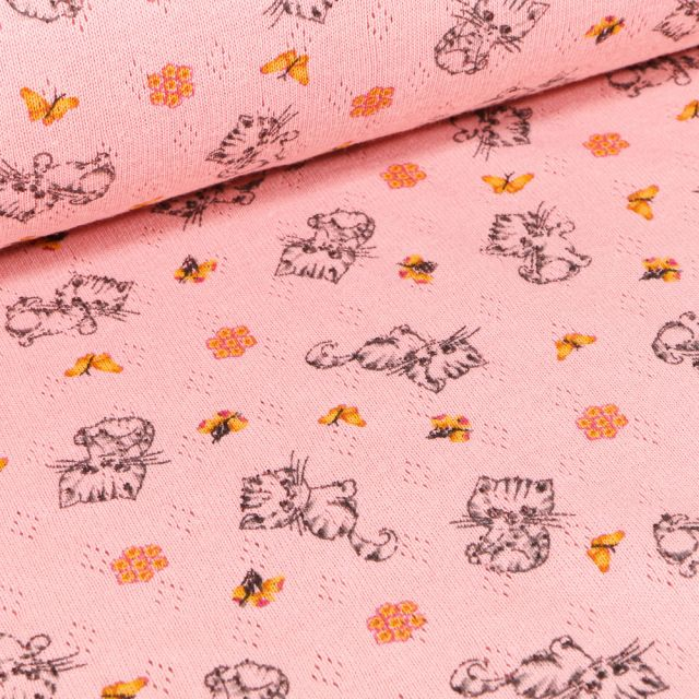 Tissu Jersey ajouré Chatons et papillons sur fond Rose